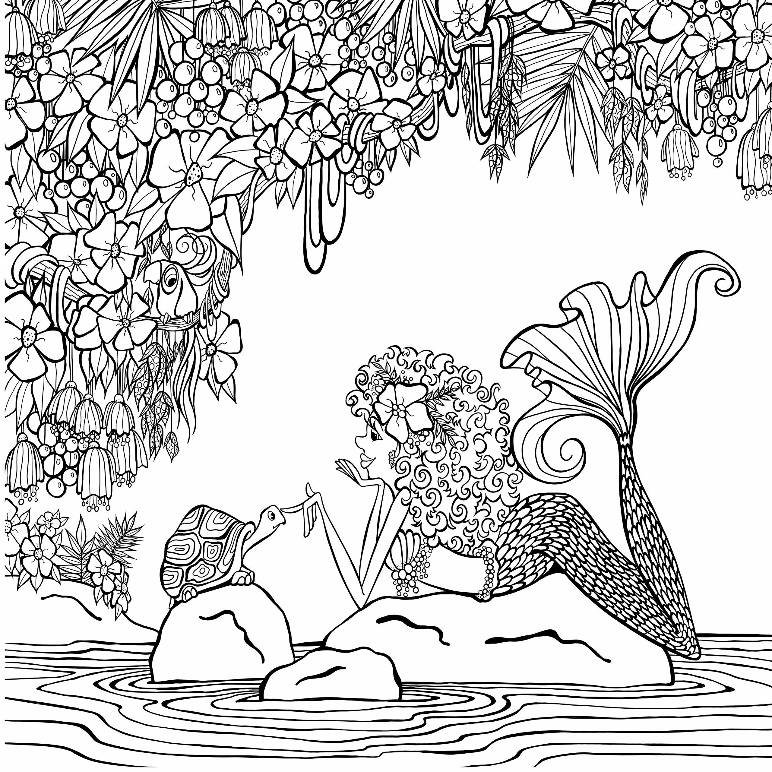 Funny mermaid on the rocks